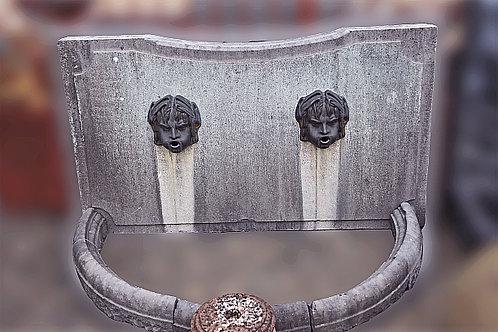 Wandfontein met 2 kinderhoofdjes