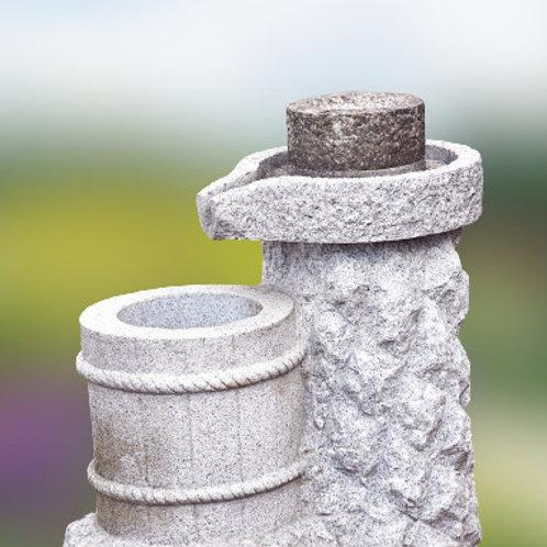 Fontein met authentiek draaiende steen
