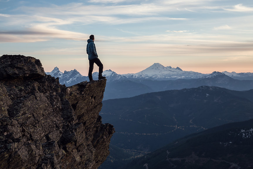 Adventurous man is standing on top of th