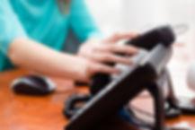 woman-answering-office-phone_0.jpg
