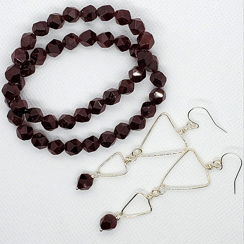 Sterling silver earrings with Garnets and matching stretch bracelet