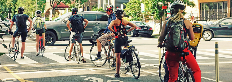 Cyclists waiting at a stoplight in a cycletrack.