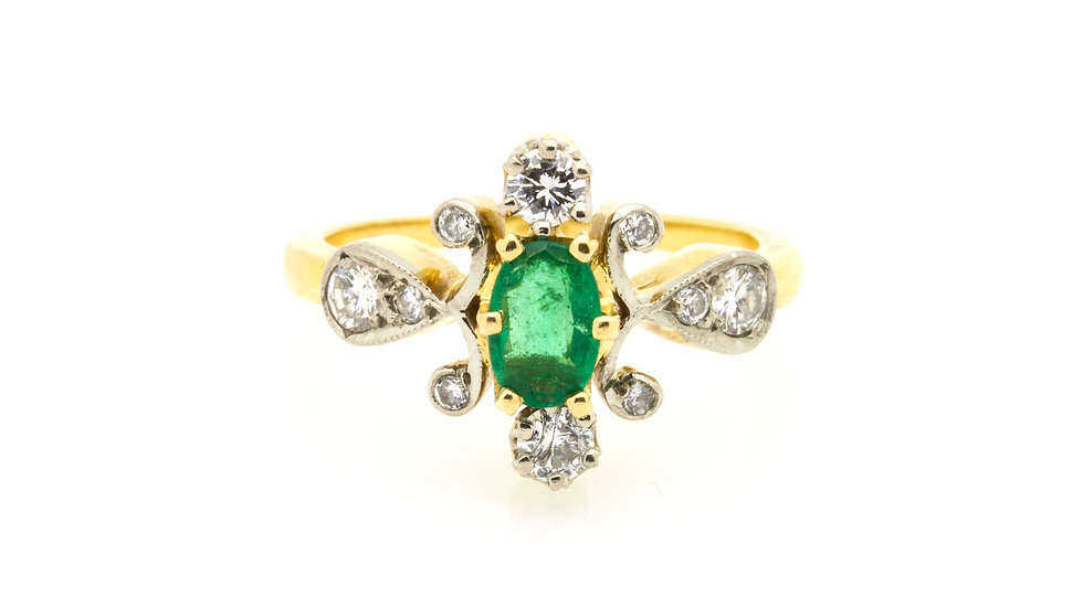 Oval Cut Emerald and Diamond Ring