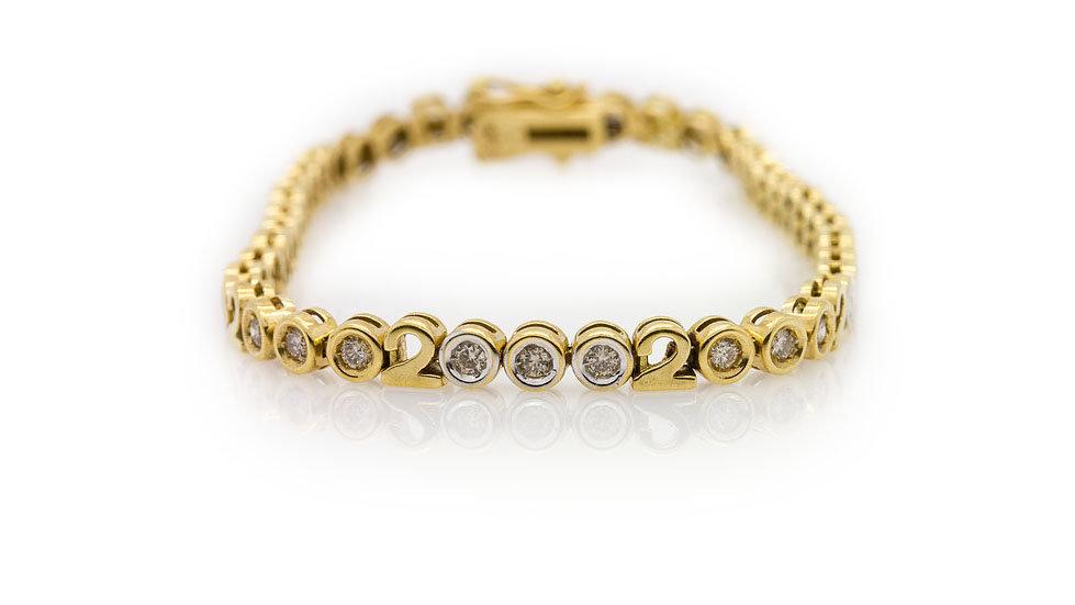 18ct yellow gold millenium bracelet with round cut diamonds
