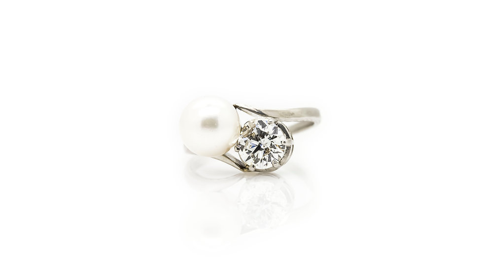 An Elegant Pearl and Diamond Bypass Engagement Ring