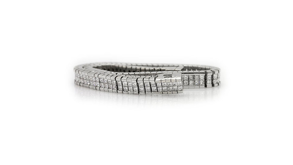 View 1 Diamond princess cut Bracelet set in 18ct white gold with a total of 5.93ct of diamonds.