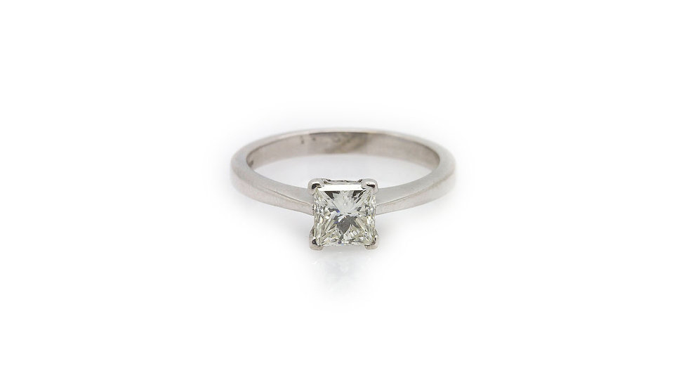 Princess cut solitaire diamond ring set in 18ct white gold