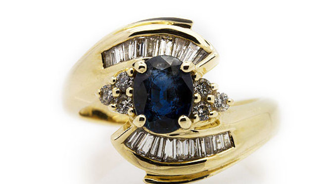 sapphire ring with baguette and round cut diamonds.
