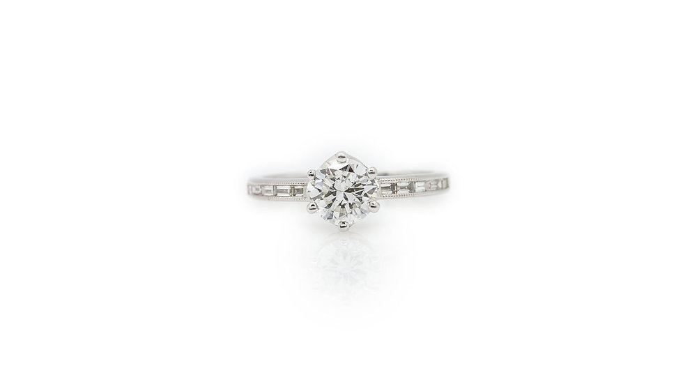 1.00ct solitaire diamond, SI1 clarity H colour with round cut diamonds on the shank