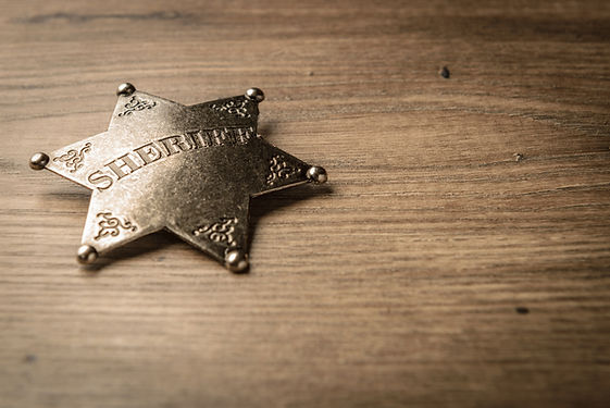 Vintage Wild West Sheriff badge on a rus