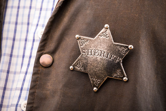 Close up of sheriff badge when on his co