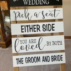 Pick a seat sign