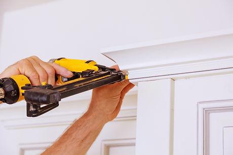 Carpenter Brad Using Nail Gun To Crown Moulding On Kitchen Cabinets Framing Trim,.jpg