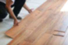 Installing laminate flooring in new home indoor.jpg