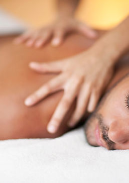 man-receiving-back-massage--143737042-5ba05b5746e0fb00509d623b.jpg