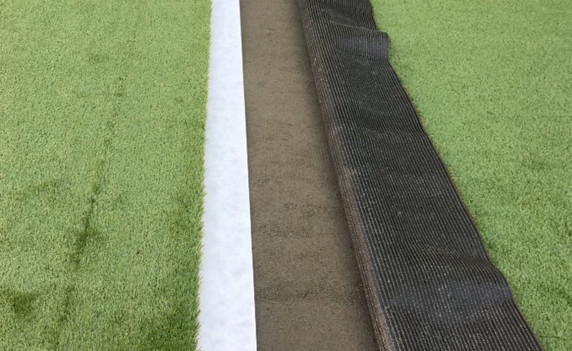 Furnish and install synthetic grass