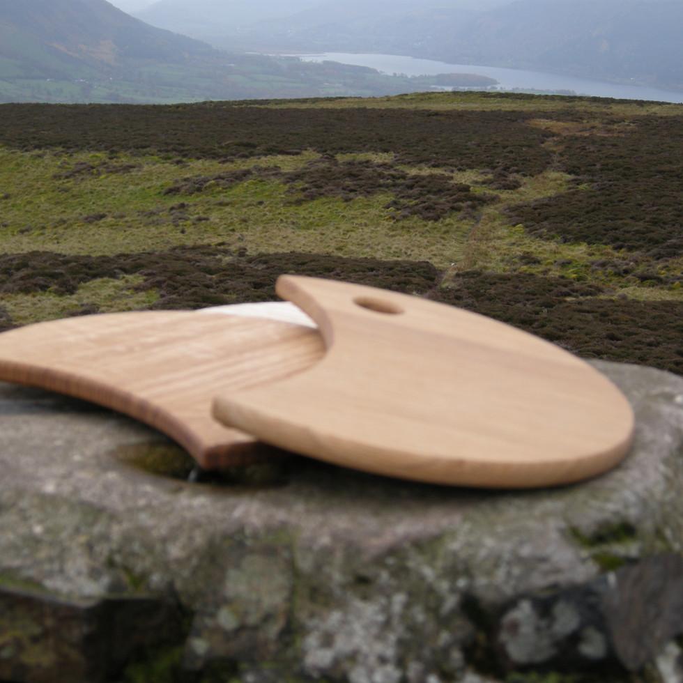 Moon shaped ash chopping boards.
