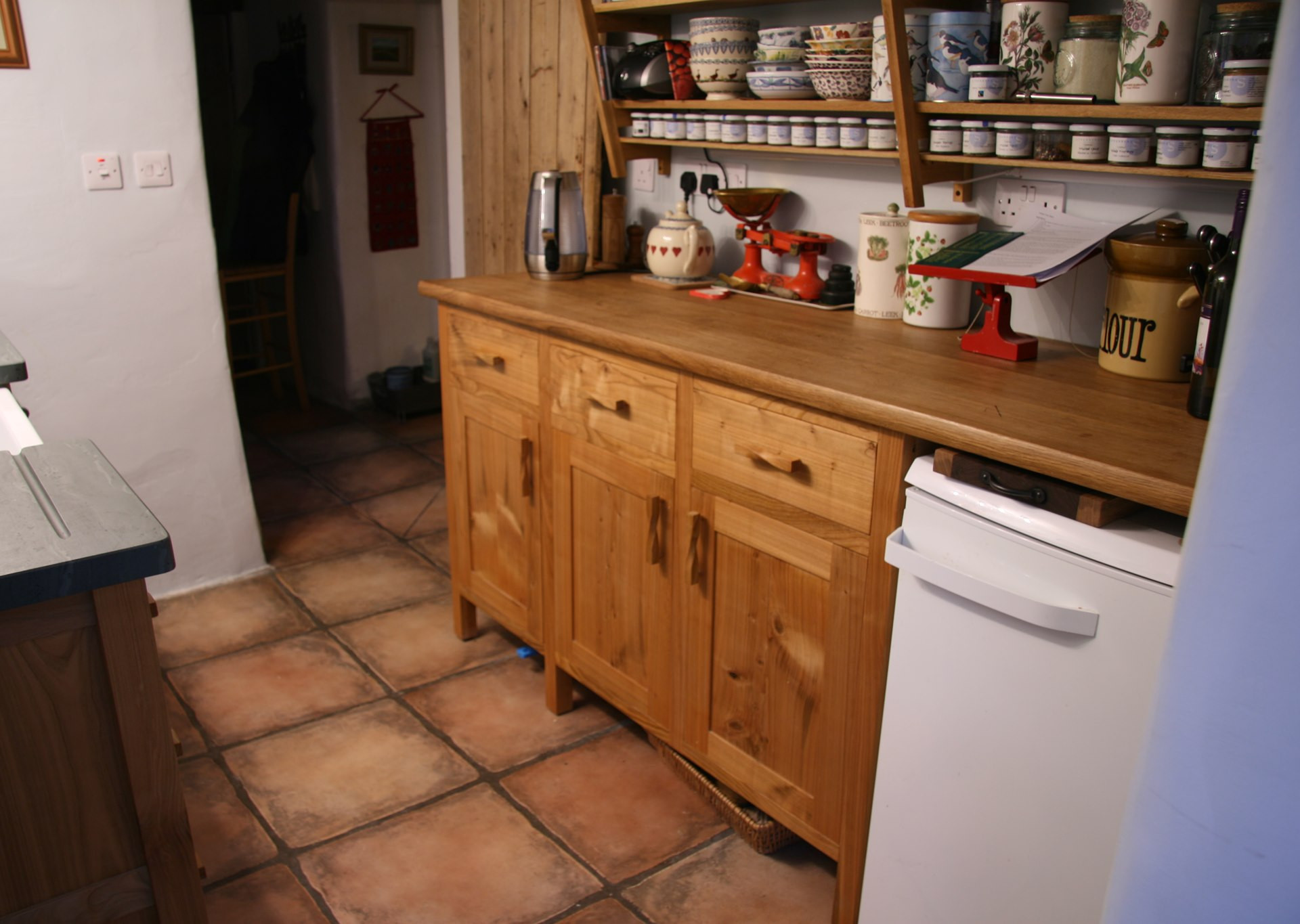 Cherry unit with three large drawers and three deep cupboards