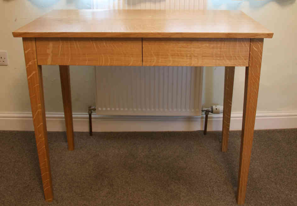 Small oak desk with two drawers