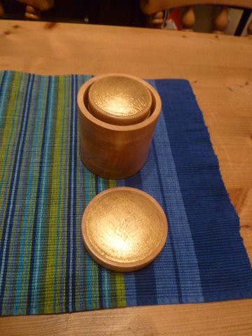A set of nesting pots with gold leaf detail to lids