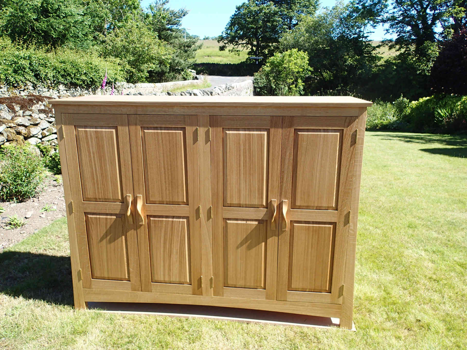 Oak cupboard with raised panels in the doors