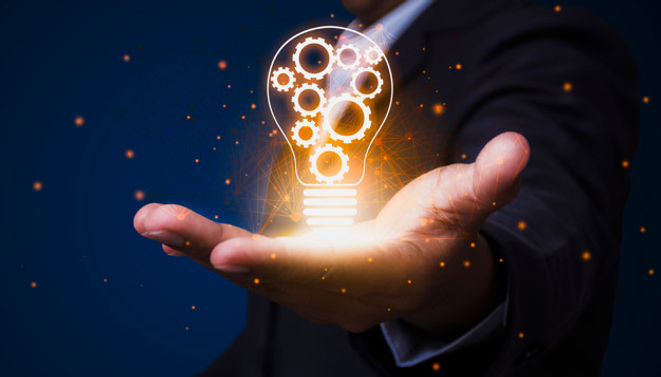 businessman-who-holds-light-bulb-with-in