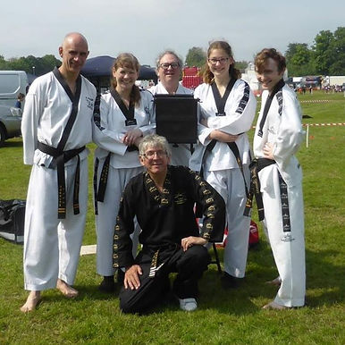 NMA Fitness Larry Day Instructor with students at Tae Kwon Do martial arts demonstration in Mildenhall Suffolk