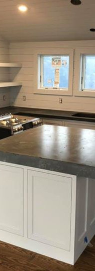 Dark gray outter kitchen with a light gray textured island