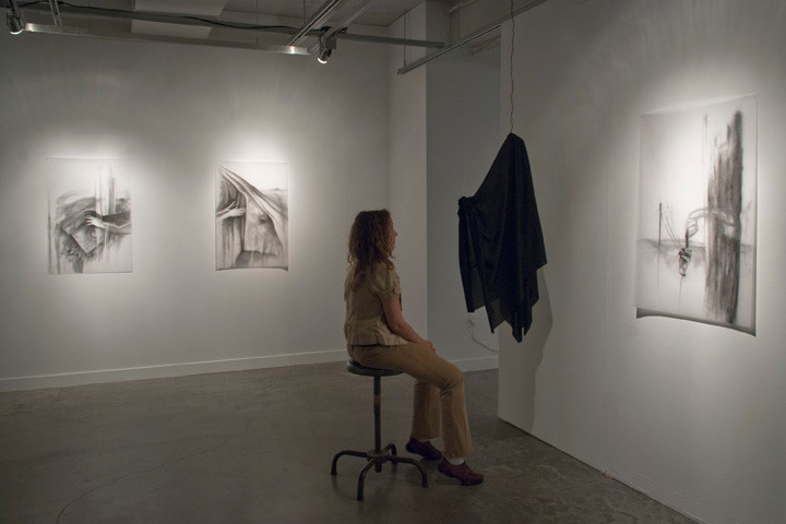 """""""Hold, Over-Reach, Re-Cover"""", video installation and charcoal drawings, 2011"""