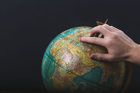 hand-points-on-globe.jpg