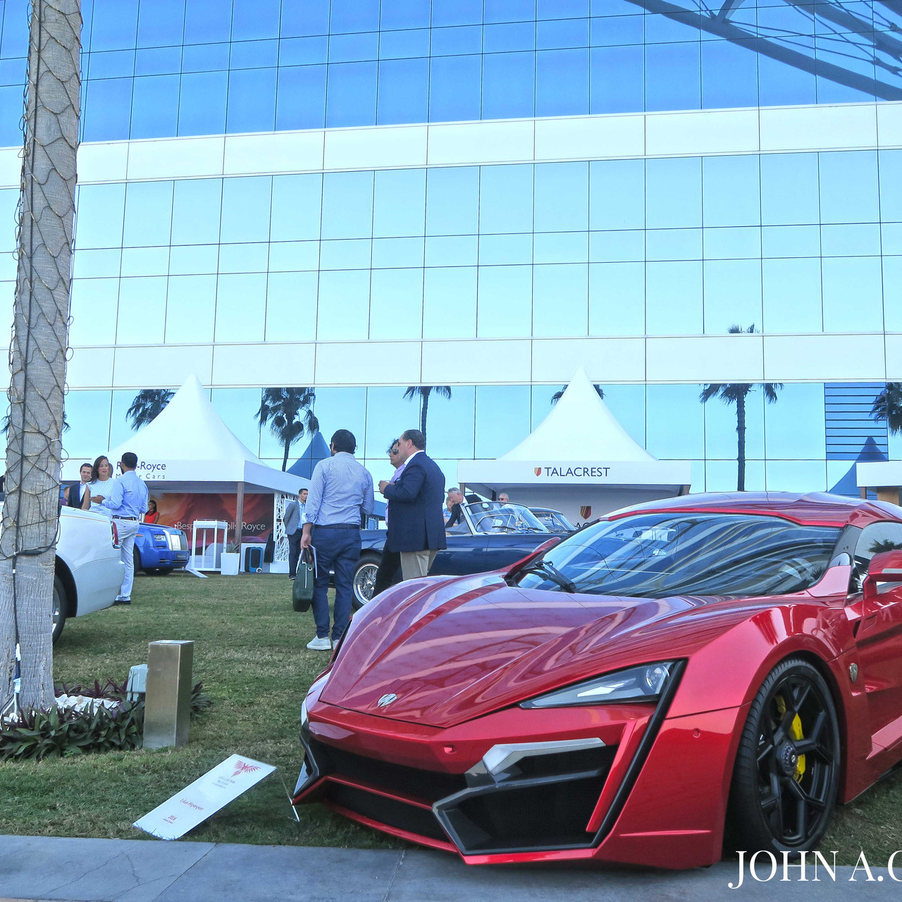 One out of only seven, the W Motors Lykan HyperSport stands on the Concours' grass with its diamond studded headlights.