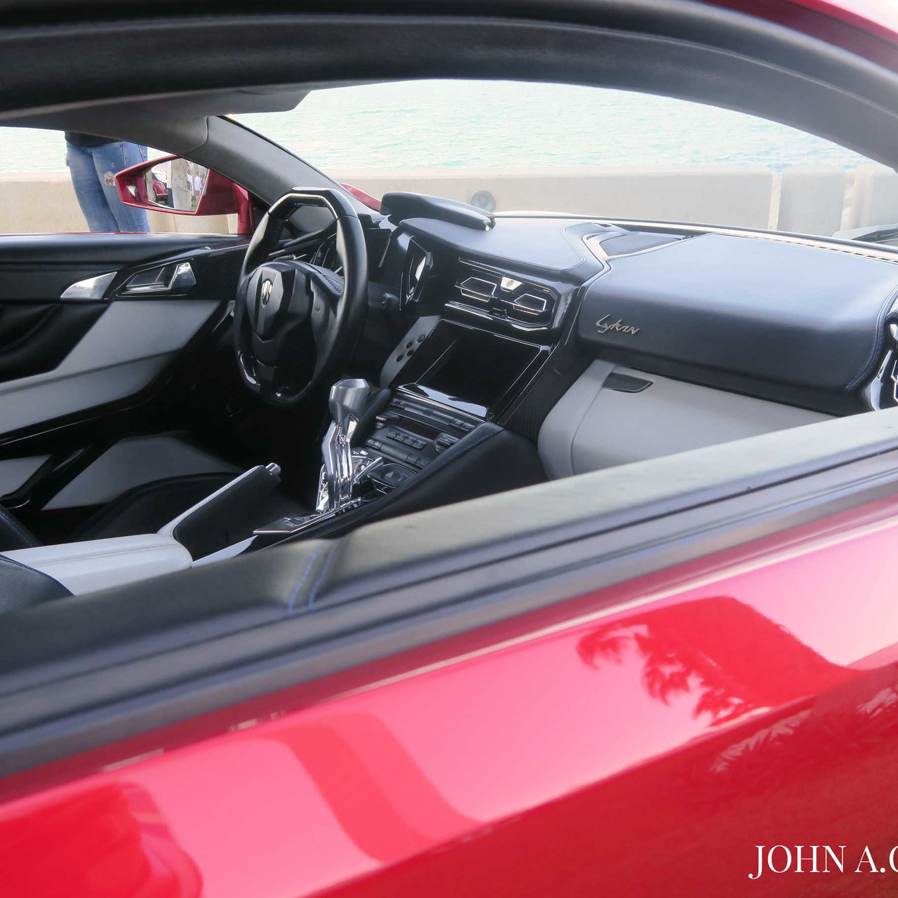 Detail of the interior featuring plenty of leather and carbon fiber details alongside an unique holographic display on the center console.