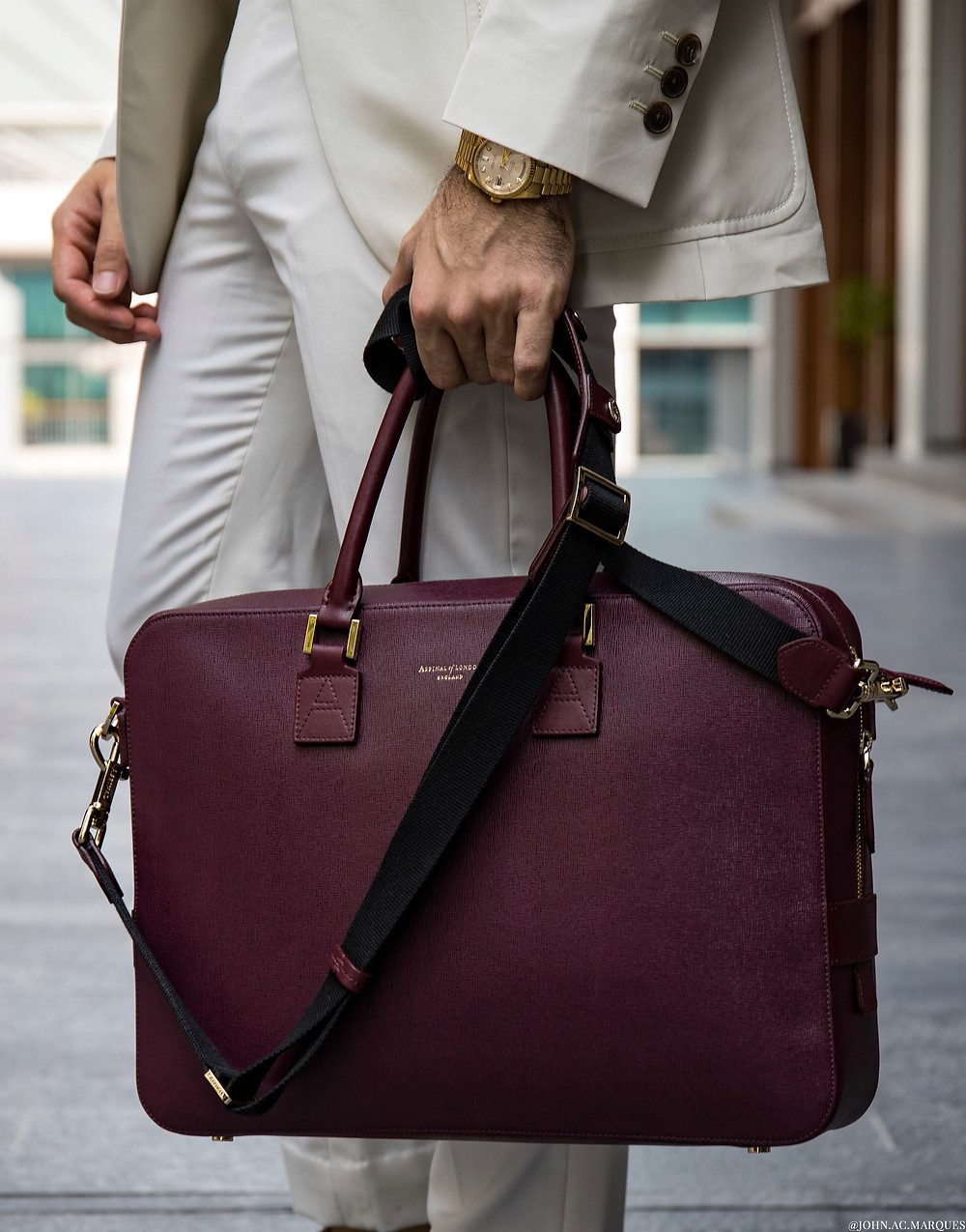Detail Shot: Gold & Diamond Rolex DayDate and Aspinal of London burgundy leather laptop briefcase.