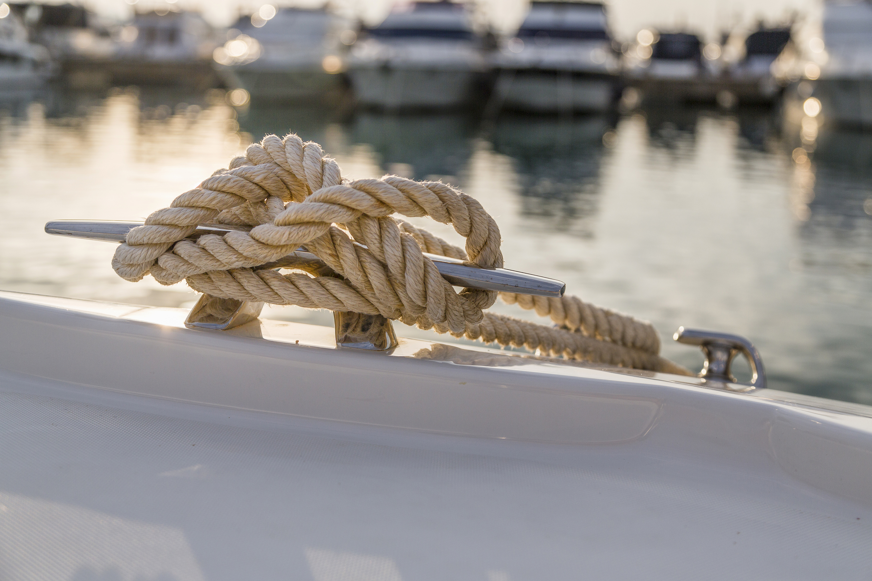 Close-up Nautical Knot Rope Tied Around Stake On Boat Or Ship, Boat Mooring Rope
