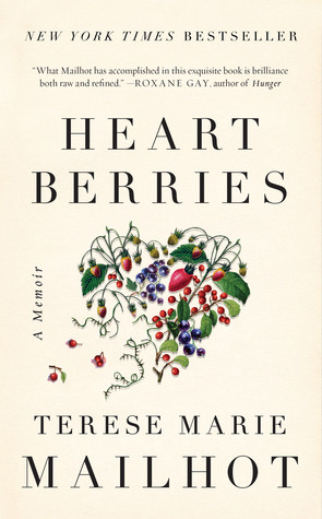 wild strawberries, blueberries and huckleberries are arranged in a heart shape with one side broken
