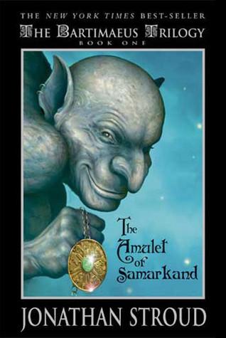 a gray, smirking goblin holds a sparkling golden pendant