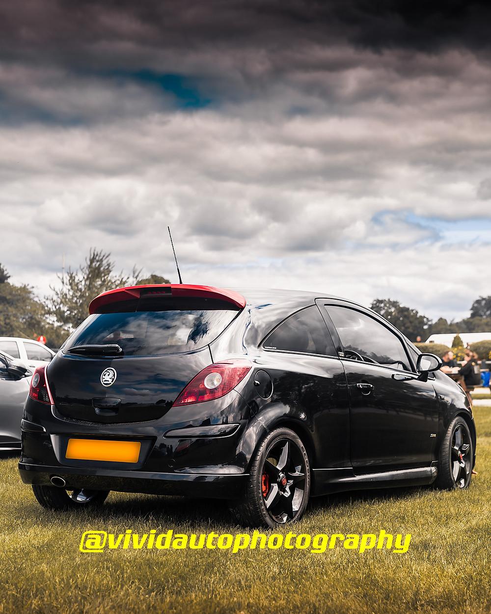 Vauxhall Corsa D | Black | Rear three quarters poster
