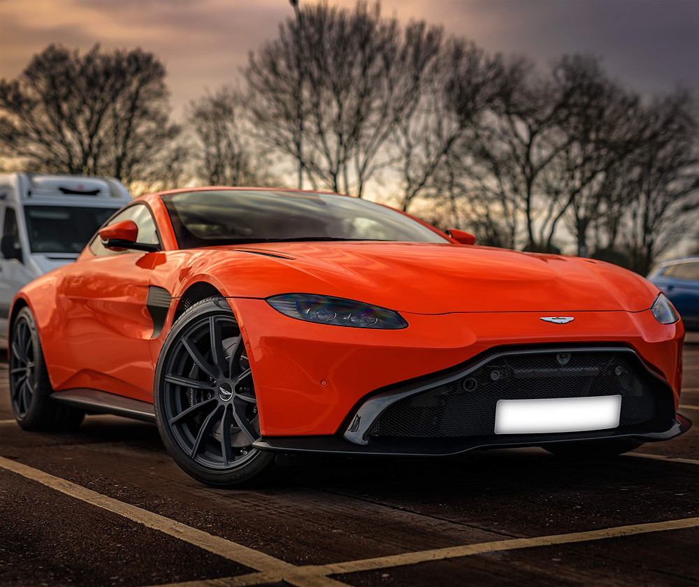 Aston Martin Vantage front three quarters | Cosmos Orange