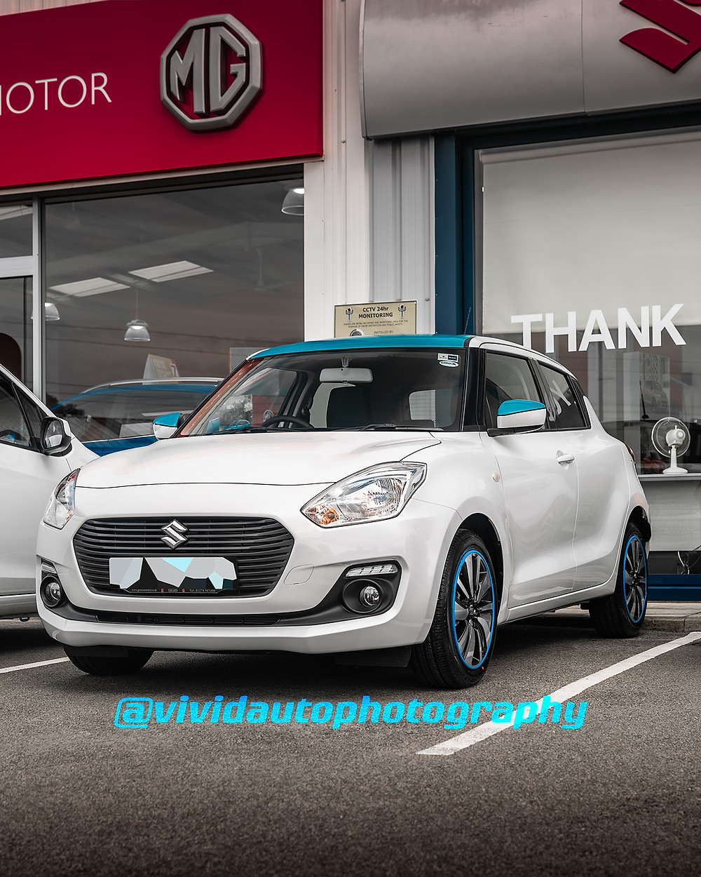 Suzuki Swift Hybrid | White, blue | Front three quarters poster