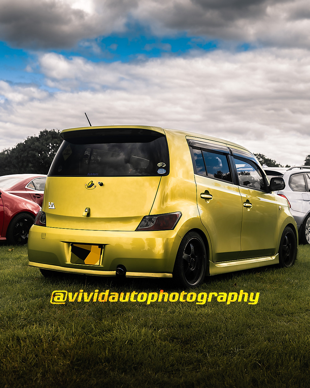 Toyota bB | Yellow | Rear three quarters poster