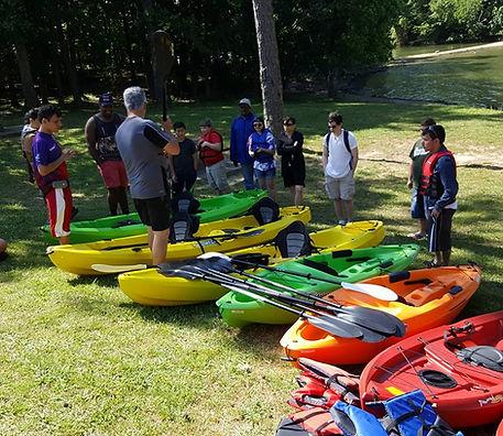 Rusty showing renter the kayaks.
