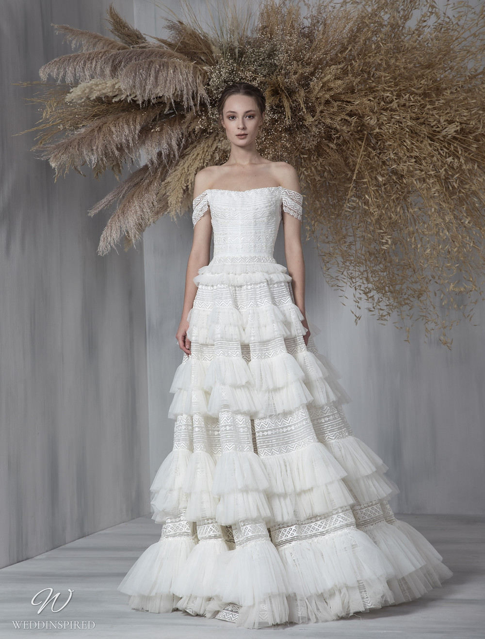 A Tony Ward 2021 off the shoulder A-line wedding dress with a ruffle skirt