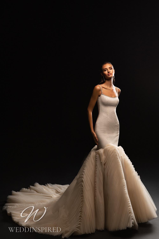 A WONÁ Concept 2021 mermaid wedding dress with a ruffle skirt