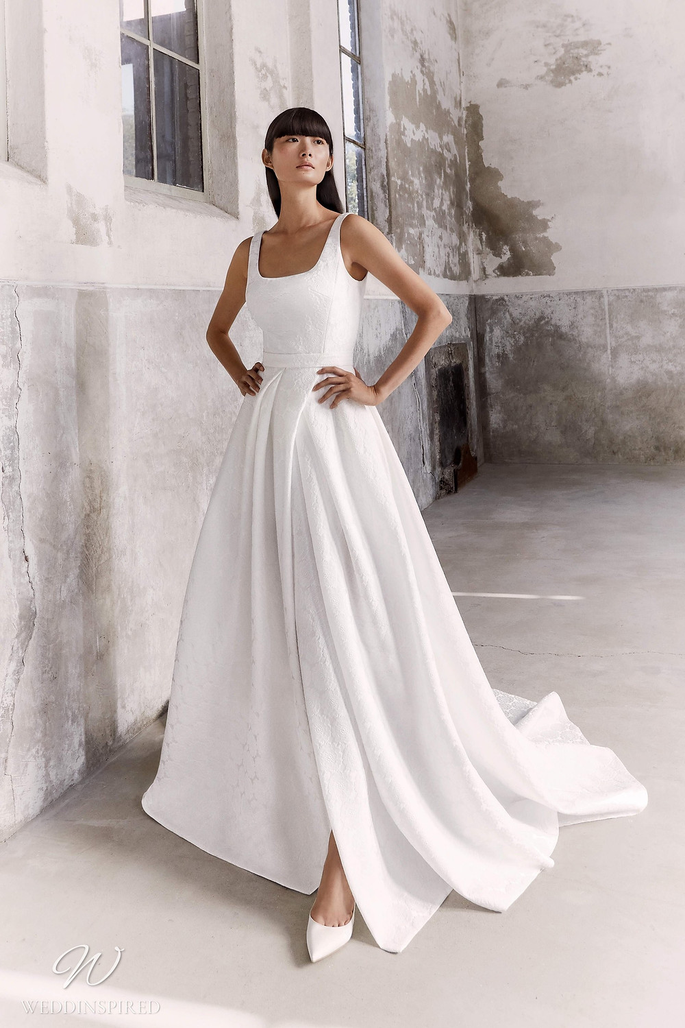 A Viktor & Rolf Fall/Winter 2021 simple A-line wedding dress with straps and a square neckline