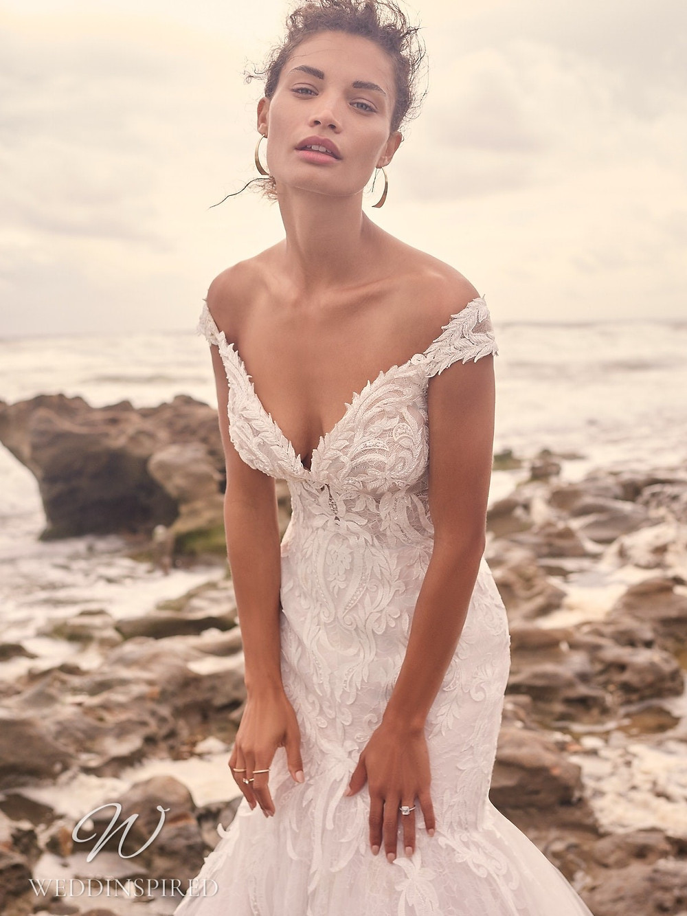 A Sottero & Midgley Spring 2021 off the shoulder lace mermaid wedding dress with a v neck
