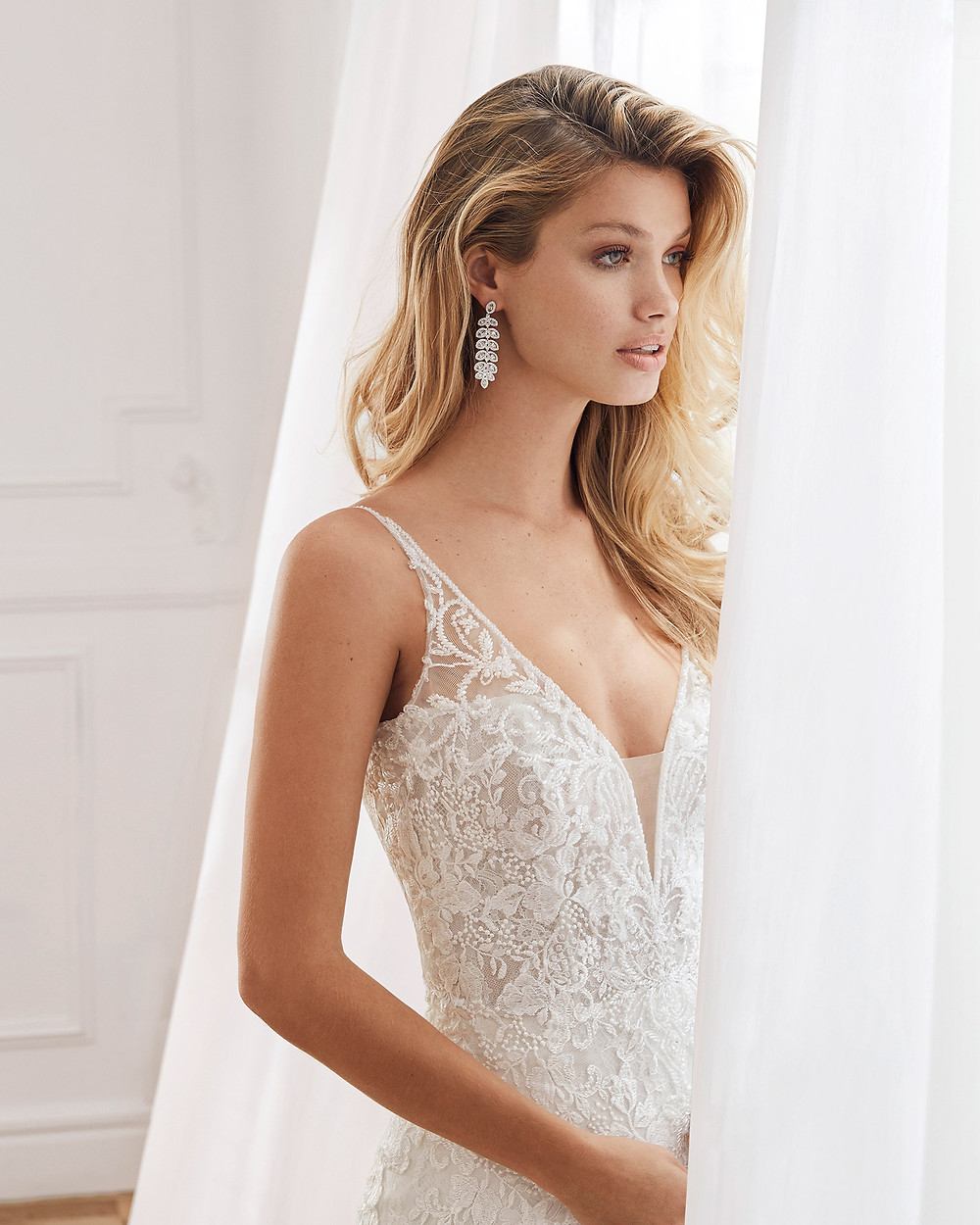An Aire Barcelona 2020 lace mermaid fit and flare wedding dress with a v neckline and straps
