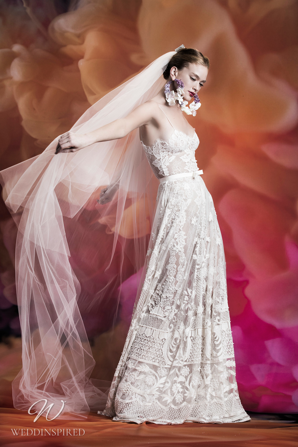 A Naeem Khan intricate lace A-line wedding dress with thin straps