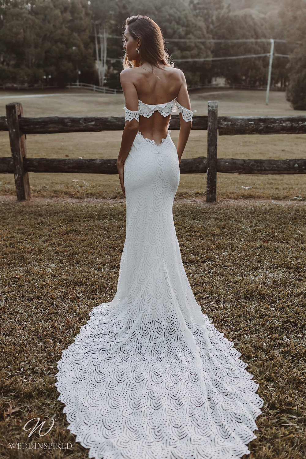 A Grace Loves Lace boho gypsy style fitted lace off the shoulder mermaid wedding dress