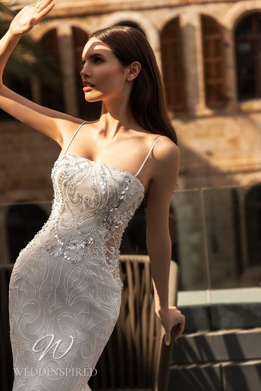 An Ida Torez 2021 lace mermaid wedding dress with a straight neckline and thin spaghetti straps