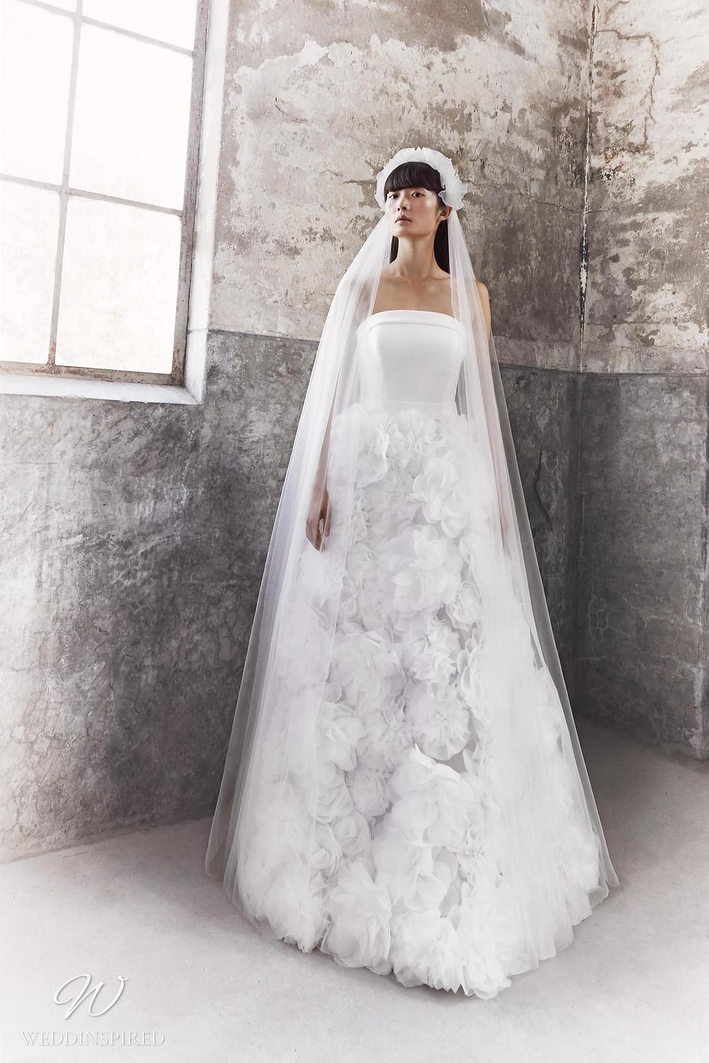 A Viktor & Rolf Fall/Winter 2021 strapless A-line wedding dress with a ruffle tulle flower skirt